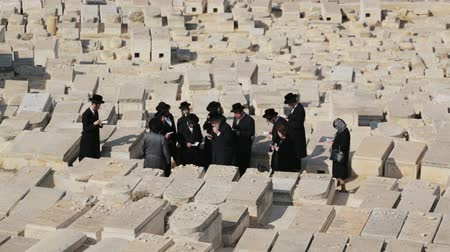 Group of Jews praying on the cemetery