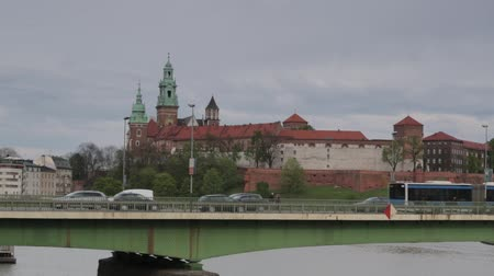 wisla : Krakow cityscape with regular traffic and Wawel royal castle, Poland Stock Footage