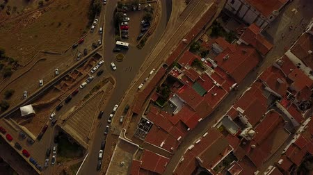 Aerial view of historic city walls of Monsaraz and parking lot for tourists in Alentejo, Portugal