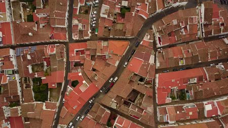Historic Evora with white houses and red roofs and car traffic from above, Alentejo, Portugal