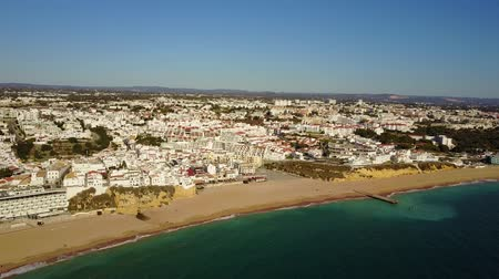 agua : Aerial view of touristic Albufeira with wide sandy beach and cliffs. Atlantic Ocean, Algarve, Portugal Stock Footage