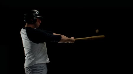 nietoperz : Baseball player hitting ball with bat shooting with high speed camera, phantom flex.