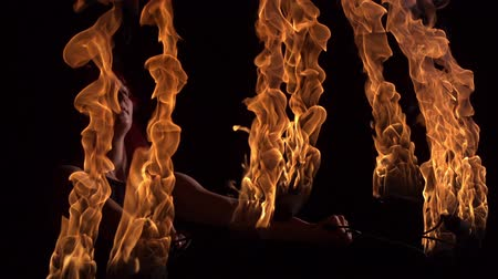 acrobata : Fire performer playing with fire shooting with high speed camera, phantom flex.