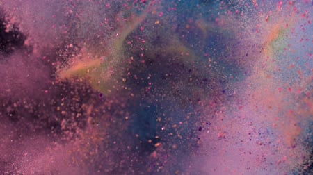 explodir : Colored particles fly after being exploded, Slow Motion Stock Footage