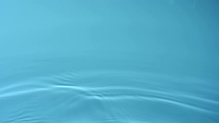 абстрактный фон : Slo-motion water rippling against blue background