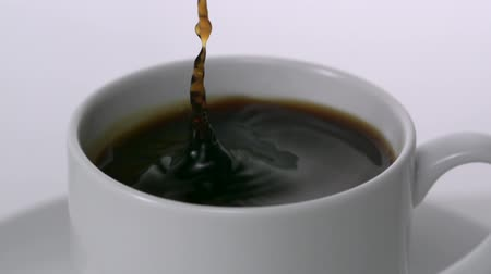 feketés csésze : Cubes of sugar poured into coffee, Slow Motion Stock mozgókép