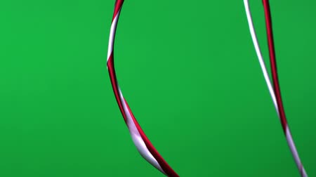 soft : Twisted red and white ribbon untwist and float down, Slow Motion Stock Footage