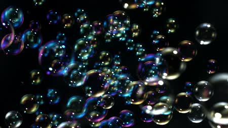 mydło : Soap bubbles on black background shooting with high speed camera.