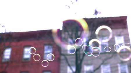 mydło : Bubbles over town house background shooting with high speed camera.