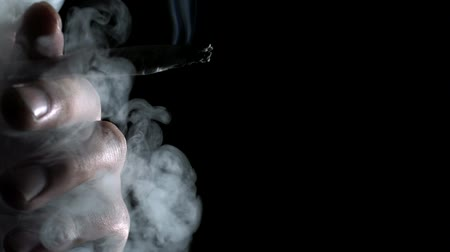 Man smoking a cigarette shooting with high speed camera.