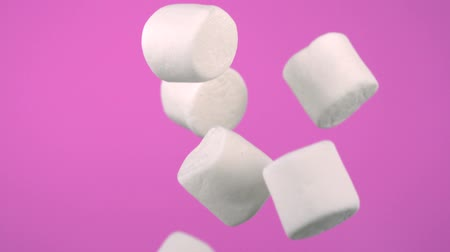 movements : Marshmallow falling shooting high speed camera. Stock Footage