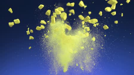 robbanás : Crushed yellow tablet explosion shooting with high speed camera. Stock mozgókép