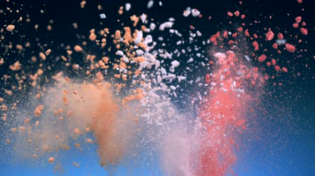 puder : Crushed red, orange and pink tablet explosion shooting with high speed camera.