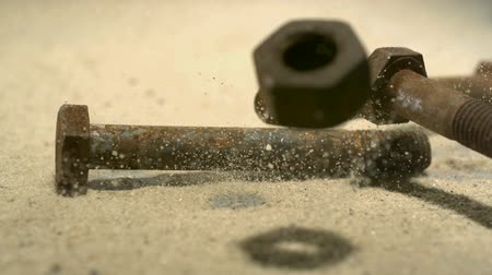 parafusos : Rusty bolts and nuts being thrown on the floor shooting with high speed camera.