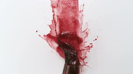 alkol : Red wine splashing out of glass shooting with high speed camera.