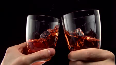 alkol : Two glasses of whiskey toasting shooting with high speed camera.