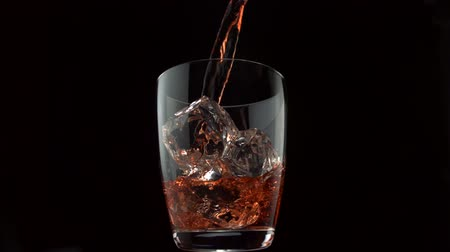 viski : Pouring whiskey into glass shooting with high speed camera, phantom flex. Stok Video