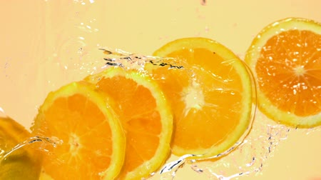 laranja : Sliced orange in water shooting with high speed camera. Stock Footage