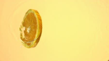 фрукты : Sliced orange spinning in water shooting with high speed camera.