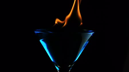 alkol : Fire blowing out of martini glass shooting with high speed camera. Stok Video