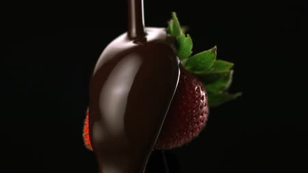 çikolata : Chocolate sauce on strawberry shooting with high speed camera.
