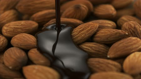 çikolata : Chocolate sauce on almond shooting with high speed camera. Stok Video