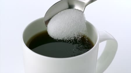 сахар : Pouring sugar into coffee shooting with high speed camera.