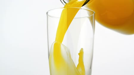 meyve suyu : Pouring orange juice into glass shooting with high speed camera. Stok Video