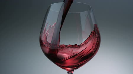 pouring : Pouring red wine into glass shooting with a high speed camera. Stock Footage