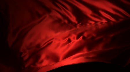 hedvábí : Red silk fabric flying in the air shooting with a high speed camera.