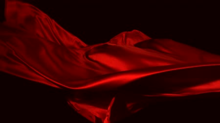 kumaş : Red silk fabric flying in the air shooting with a high speed camera.