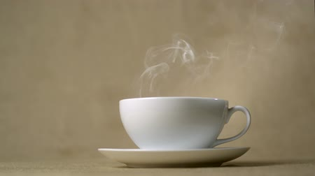 hot beverage : Steam coming out of cup of hot drink shooting with high speed camera, phantom flex. Stock Footage