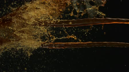movements : Pouring coffee and making splashes on black background shooting with high speed camera, phantom flex.