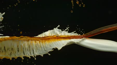 feketés csésze : Pouring coffee  milk and making splashes on black background shooting with high speed camera, phantom flex.