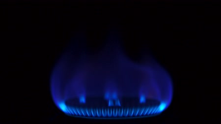 gas : Turning on gas stove on black background shooting with high speed camera, phantom flex. Stock Footage