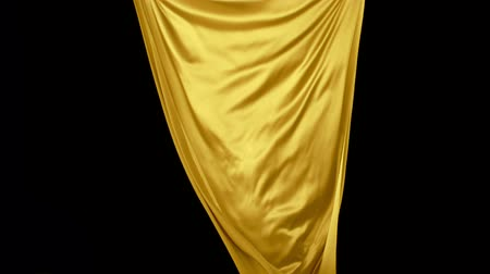 soft : Yellow fabric flowing in the air on black background shooting with high speed camera, phantom flex. Stock Footage
