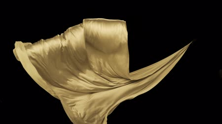 kumaş : Yellow fabric flowing in the air on black background shooting with high speed camera, phantom flex. Stok Video