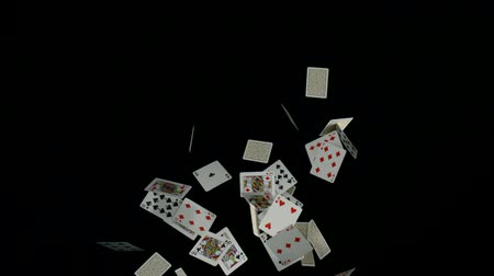 покер : Playing cards falling on black background shooting with high speed camera, phantom flex.