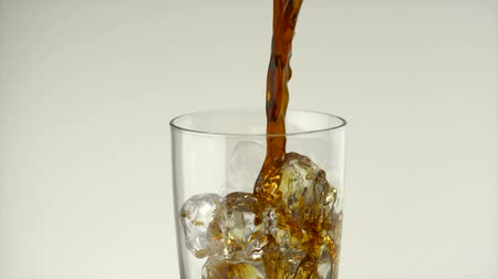 feketés csésze : Pouring coffee onto ice in glass shooting with high speed camera, phantom flex. Stock mozgókép