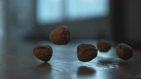 jíst : Walnuts falling on wooden table. Shot with high speed camera, phantom flex 4K.  Slow Motion. Unedited version is included at the end of clip.