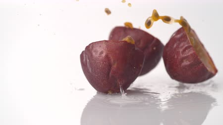 tutku : Passion fruit falling and bouncing on water surface. Shot with high speed camera, phantom flex 4K.  Slow Motion. Stok Video