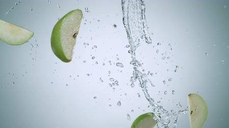 meyve suyu : Pear colliding against water stream. Shot with high speed camera, phantom flex 4K. Slow Motion. Stok Video