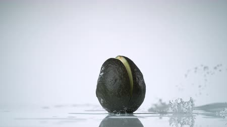 avokado : Cut avocado and water splash. Shot with high speed camera, phantom flex 4K. Slow Motion.