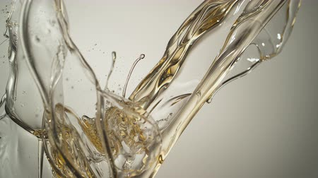 olivový olej : Pouring oil and making splashes. Shot with high speed camera, phantom flex 4K. Slow Motion.