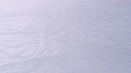 léčit : Single flower dropped onto water surface. Shot with high speed camera, phantom flex 4K.  Slow Motion. Unedited version is included at the end of clip.