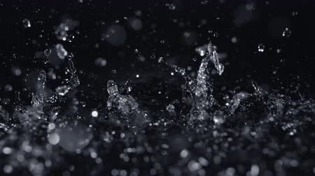 deszcz : Pouring water into puddle shot with motion control and high speed camera, phantom flex 4K.