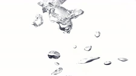 lassú : Water bubbles rising against white background. Shot with high speed camera, phantom flex 4K.  Slow Motion.