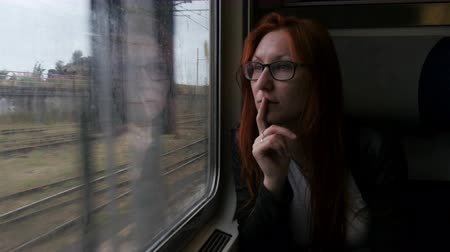 szicília : 4K Attractive woman in thought looking out of a train window