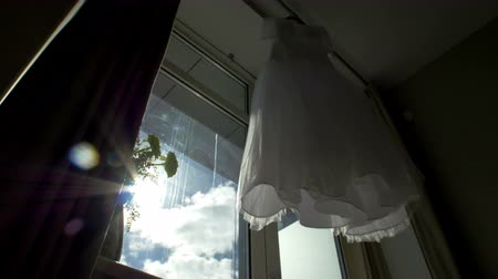 подвенечное платье : Beautiful wedding dress hanging in a window.