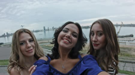 looking : Three Attractive young women on high hill get a selfie, pov